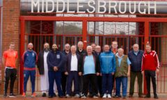 FFIT group pose for a photo outside the Ayresome Gates