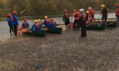 Group of young people about to go canoeing
