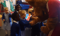 Roary gives a young boy a high five