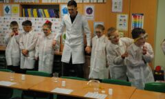Stewart Downing takes part in an experiment with some pupils
