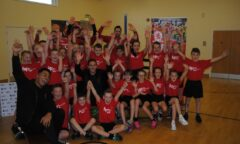 Stewart Downing and a P.E. class raise their hands in the air