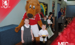 Roary and two pupils pose for a photo
