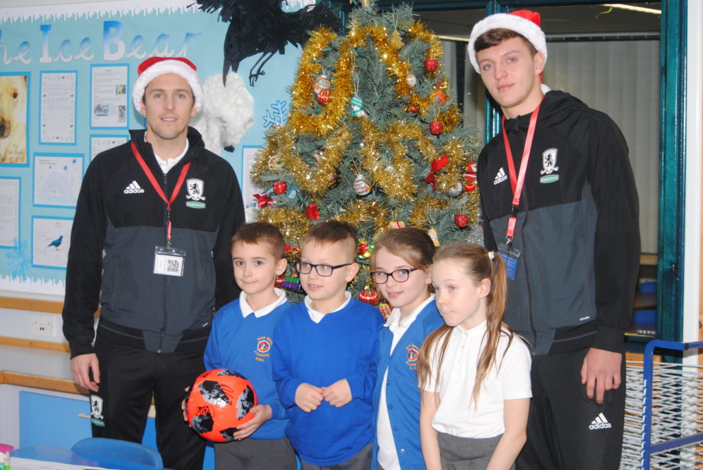 Stewart Downing and Dael Fry pose with children from Rose Wood Academy