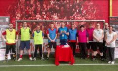 Winning team in football hold a trophy