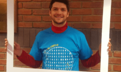 George Friend wearing an NCS t-shirt posing for a photo through a large frame