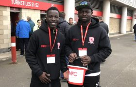 Two volunteers bucket collecting for MFC Foundation