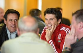 George Friend smiles as he talks to members of Team Talk