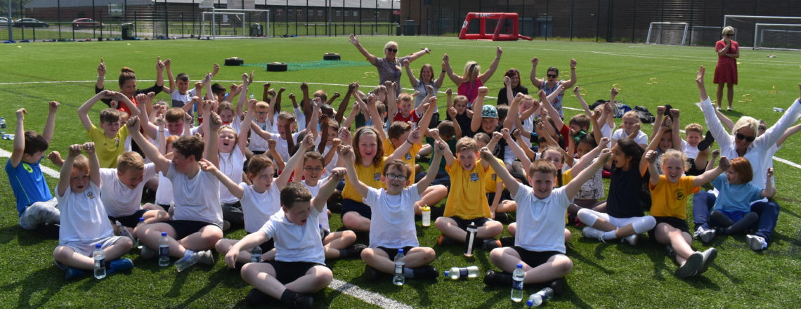 Primary School Pupils Have Fun In The Sun At Roary's Sports Day