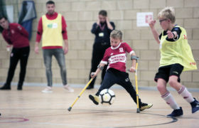 Middlesbrough FC scholar helping a child